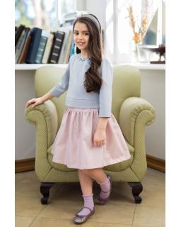 Rozkloszowana spódnica z jasnoróżowej tkaniny dla dziewczynki