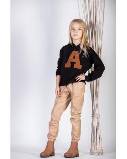 Dziewczęce spodnie z eco skórki na welurze 128-158 G-326 beżowe
