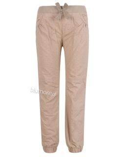 Dresowe spodnie w grochy dla dziewczynki 98 - 128 Sp04 beż